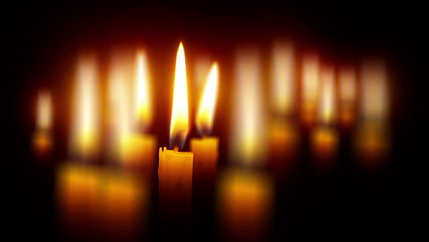 Many candles with shallow depth - religious theme on black wide perspective