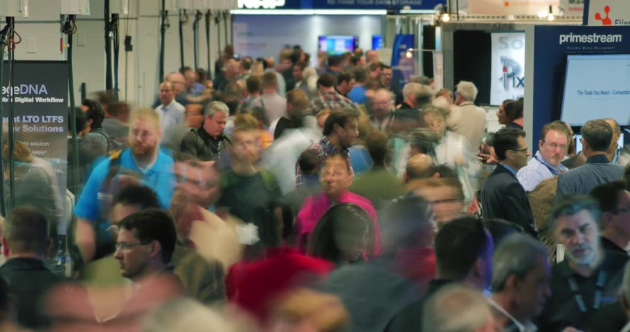 LAS VEGAS - April 20, 2016: Crowds of people at NAB Show 2016 exhibition in Las Vegas Convention Center. NAB Show is a trade show produced by the National Association of Broadcasters. 4K UHD timelapse