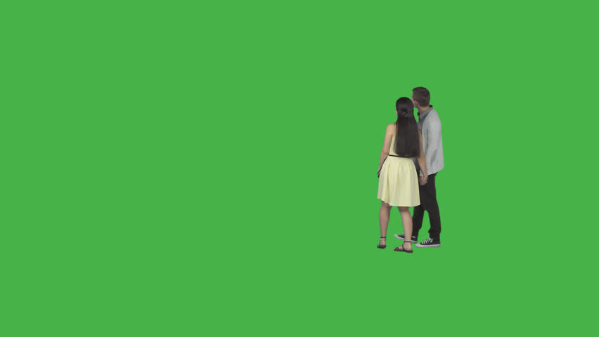 Guy & girl in yellow dress walks holding on hands and examines something. Footage with alpha channel. File format - .mov, codec PNG+Alpha. Shutter angle -180 (native motion blur)