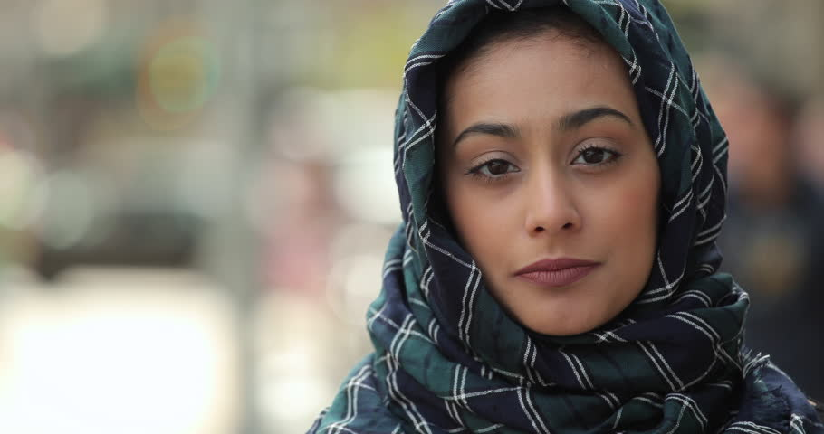 Young woman wearing hijab in city serious to smile face portrait | Shutterstock HD Video #16137949