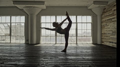 April 2016 - Los Angeles: Female doing yoga in a studio with natural light