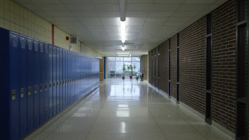 Long, Clean, Empty School Hallway with Blue Lockers and Reflective Floor