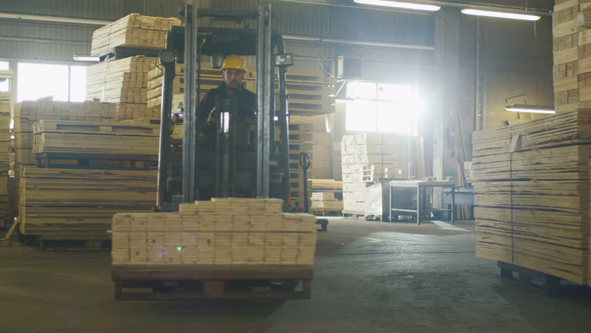 Forklift operator is driving in lumber factory warehouse shot on forklift operator is driving in lumber factory warehouse shot on red cinema camera in 4k uhd stock footage video 100 royalty free 16177552 publicscrutiny Image collections