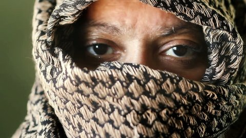 Middle Eastern woman eyes closeup wearing traditional Shemagh Arab head wrap scarf