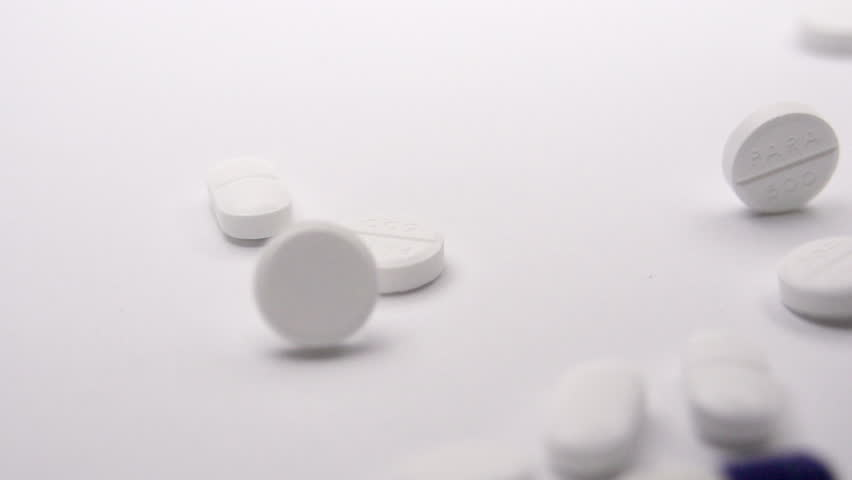 Medication Drugs Falling In Slow Motion On White Background