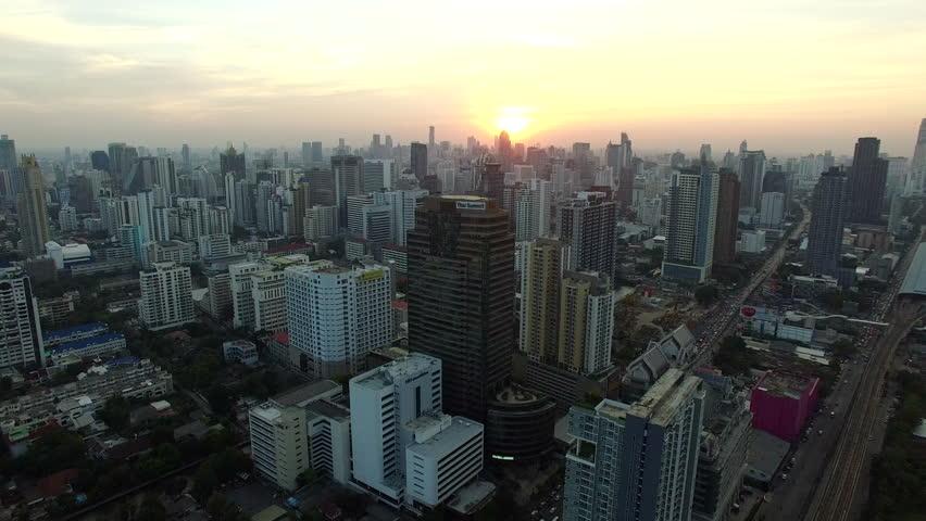 Aerial view of bangkok skyline against sun set sky | Shutterstock HD Video #16211341