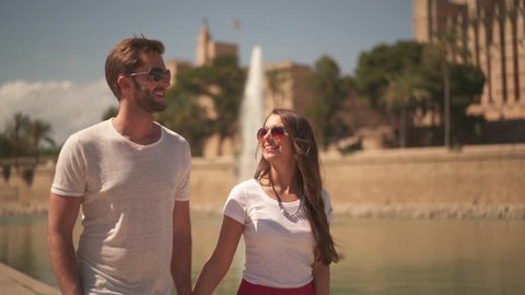 4k footage, happy young couple walking together on city sightseeing in Palma de Mallorca