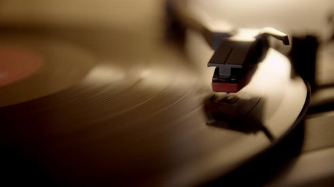 Record player turntable UHD stock footage. A record player turntable with it's stylus running along a vinyl record
