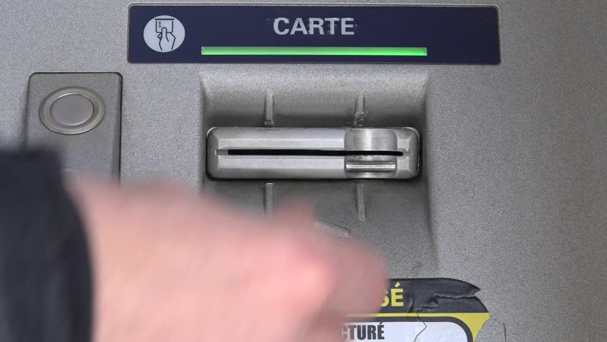 Man Uses ATM Card In Cash Machine, France. Automated teller machine is an electronic telecommunications device that enables the customers to perform financial transactions. | Shutterstock HD Video #16235002