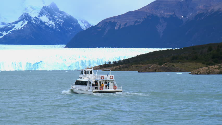White ship running in front of Perito Moreno Glacier in Argentina