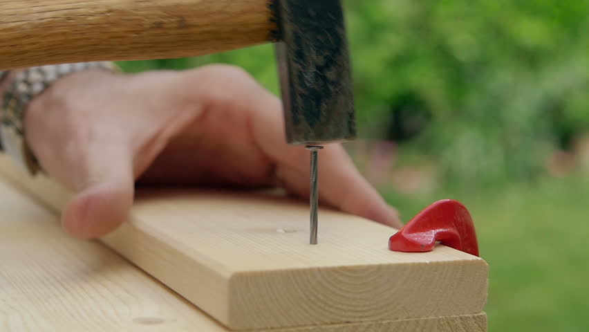 Carpenter nailing a wooden board with a slow motion part | Shutterstock HD Video #16240852
