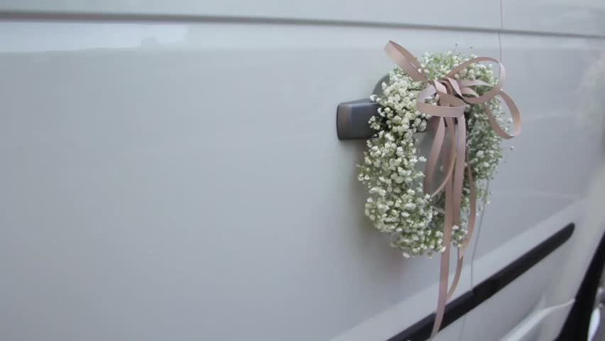 Decoration wedding car with wedding flowers and satin ribbons stock wedding car decorated with wedding flowers on the door handles hd stock video clip junglespirit Gallery