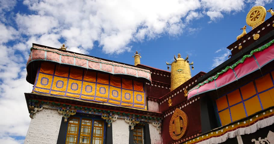4k closeup of The Jokhang Temple In Lhasa,Tibet,white clouds in blue sky. gh2_09637_4k
