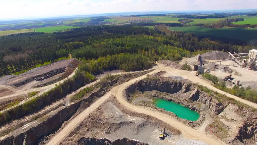 Flight over open cast mine. Aerial view of industrial landscape after mining. Industry and environment in Czech Republic, European Union.