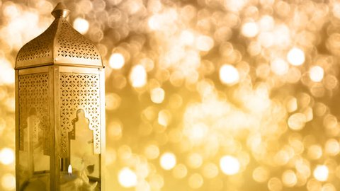 Arabic ornamental lantern with burning candle and glittering bokeh lights background, loopable Ramadan HD footage
