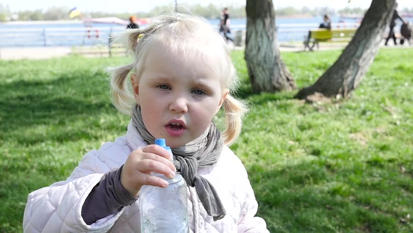 little kid girl drinking a pure fresh water from a nippled bottle stock footage video 16322872 shutterstock