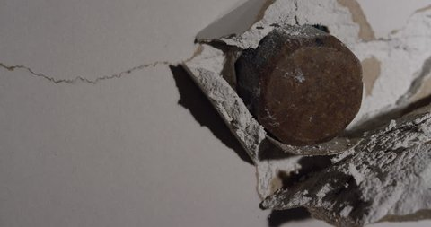 Smash through Drywall with hammer in slow motion