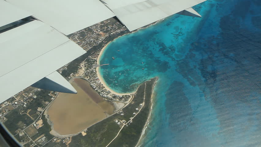 Flying over beach town of Sandy Ground in Anguilla. Note some smudges on plane window.