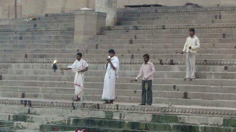 VARANASI, INDIA - NOV 5, 2009 - Young Brahmin priests conduct  Morning blessings on ghats of the Ganges,on Nov 6, 2009, in Varanasi, India.