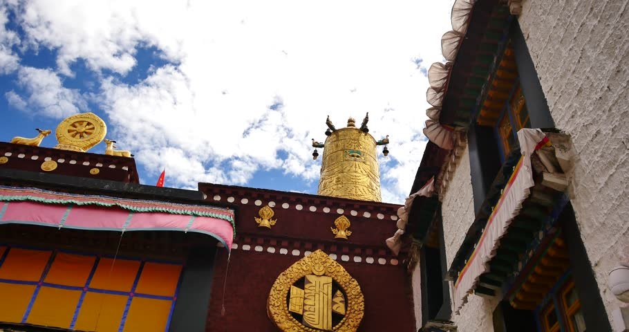 4k closeup of The Jokhang Temple In Lhasa,Tibet,white clouds in blue sky. gh2_09638_4k