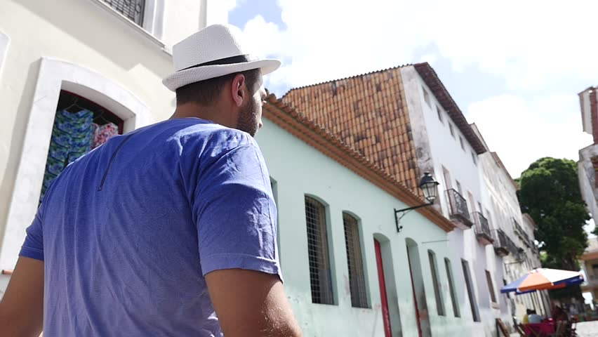 Tourist walking old colonial district (Pelourinho) of Salvador, Brazil