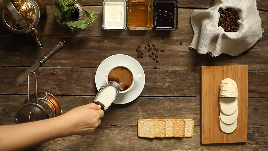 coffee. vintage. wooden background.  top view. fresh cream poured into a black strong coffee.  overhead horizontal view