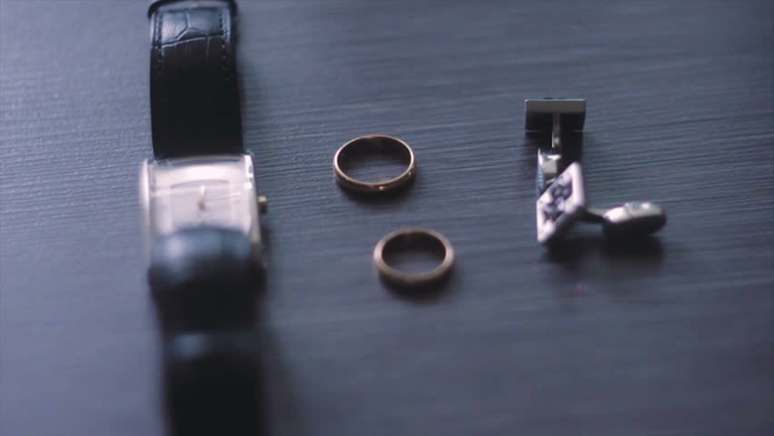 Mechanical Watches With Black Strap. Above Them Are Two Wedding Rings. Above Are Two Gold Cufflinks. | Shutterstock HD Video #16428172