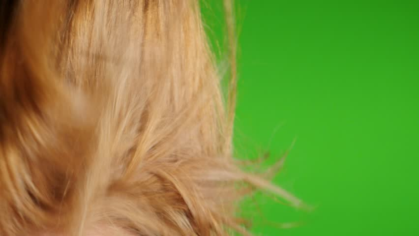 Slow motion air-drying woman blonde hair in front of green screen 1920X1080 HD footage - Hair blow-drying of  blond female chroma key greenscreen 1080p FullHD  slow-mo video - HD stock footage clip