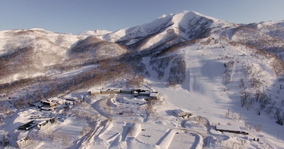 Snowy Mountain Town Fly Over | Shutterstock HD Video #16457872