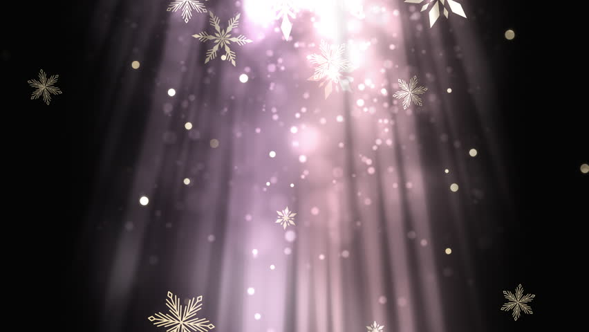 Christmas background of winter snowflakes falling slowly down a brilliantly lit light streaked background
