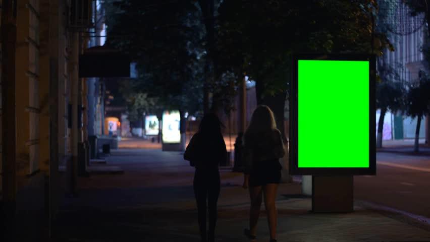 Girls walking down the street at night, Billboard template, green screen | Shutterstock HD Video #16480126