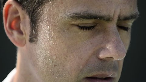 Extreme close-up of a male tennis player's mouth with sweat on his face. - Model Released - 1920x1080 - Full HD