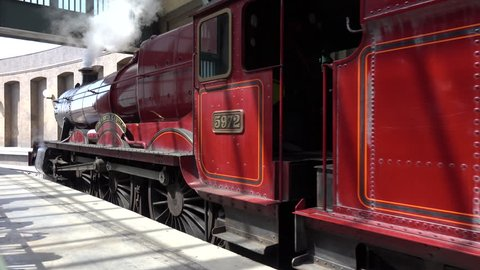 UNIVERSAL STUDIOS, FLORIDA - MARCH 18, 2016: The Wizarding World Of Harry Potter features the Hogwarts Express Locomotive Passenger Train Connecting The Two Harry Potter Attractions for park visitors.