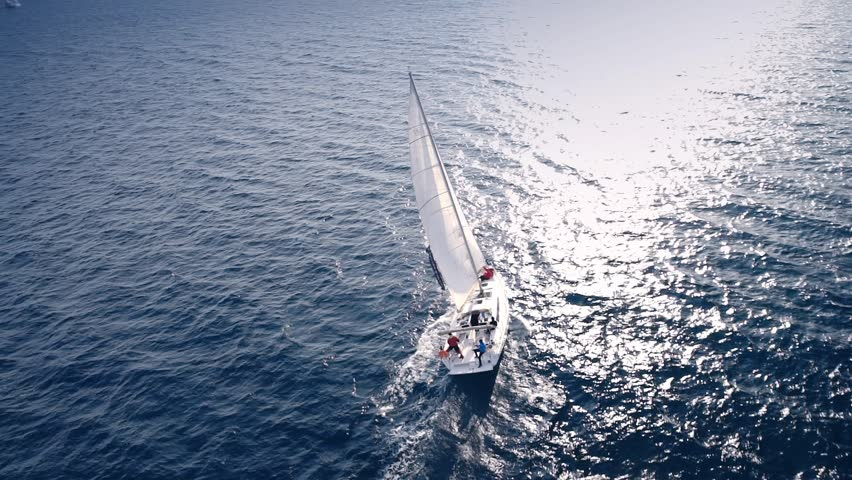 Yacht sailing on opened sea. Sailing boat. Yacht from drone. Yachting video. Yacht from above. Sailboat from drone. Sailing video. Yachting at windy day. Yacht. Sailboat. #16596532