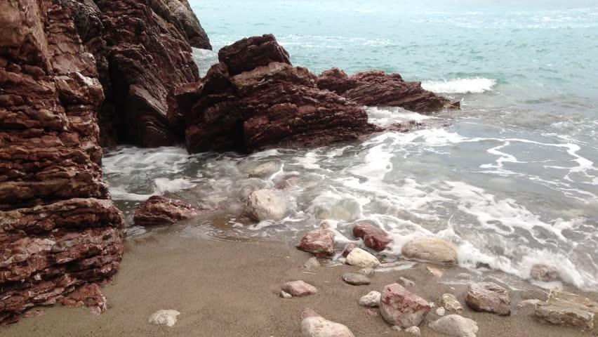 Sea surf. Waves crashing on coastal rocks. Video   Shutterstock HD Video #16599592