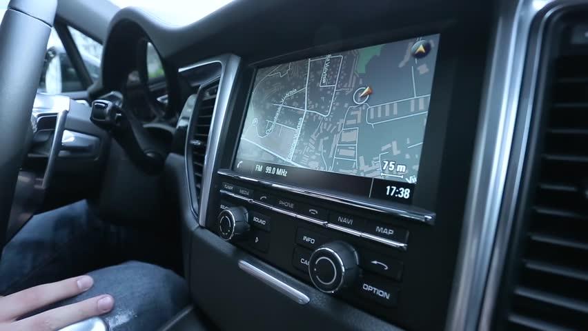 Man uses a navigator in the car. | Shutterstock HD Video #16648987