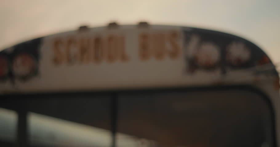 Chicago, IL - October 2015: Close up of a rusty school bus on a farm at dusk