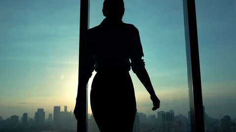 Young woman admire cityscape during sunset, slow motion