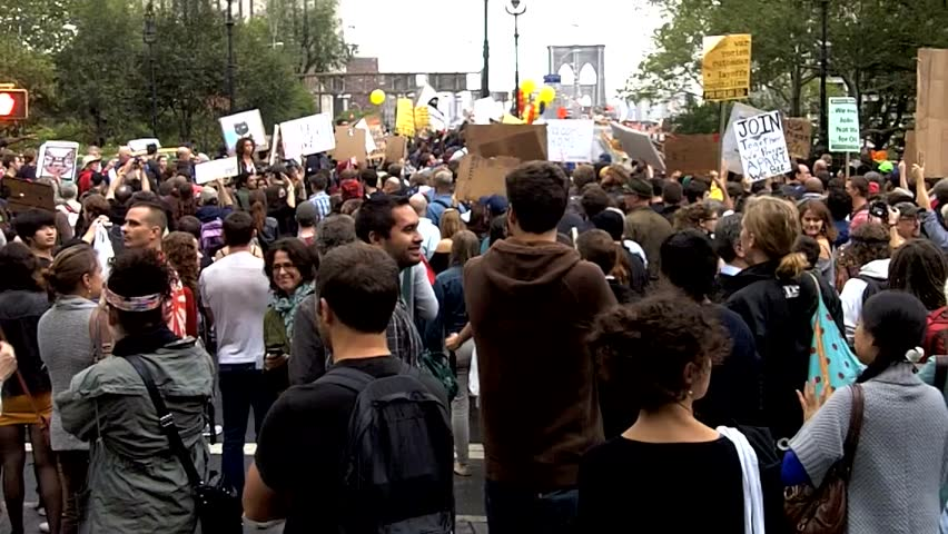 NEW YORK - OCTOBER 1: Occupy Wall Street protesters march over the Brooklyn Bridge, on October 1, 2011 in New York City. Police arrested many of the demonstrators for blocking the roadway.