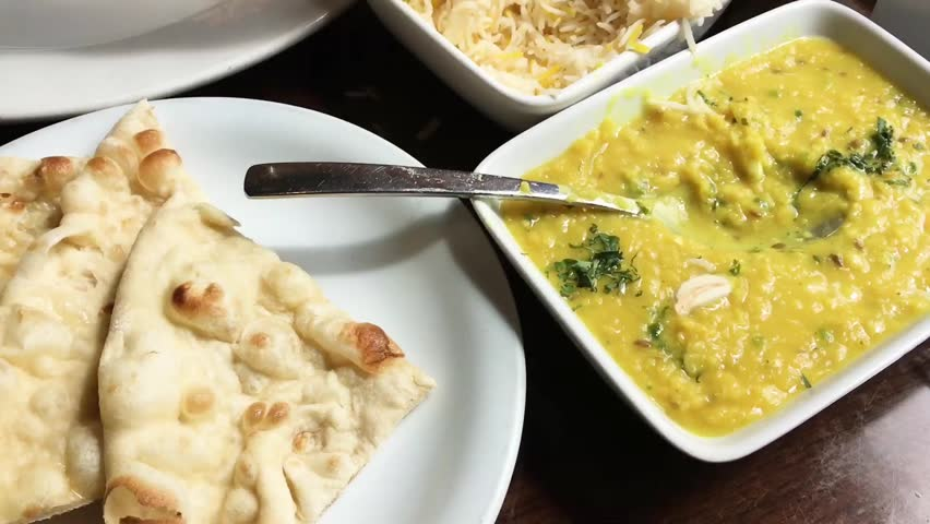 Lentil dhaal and nan bread in an indian restaurant