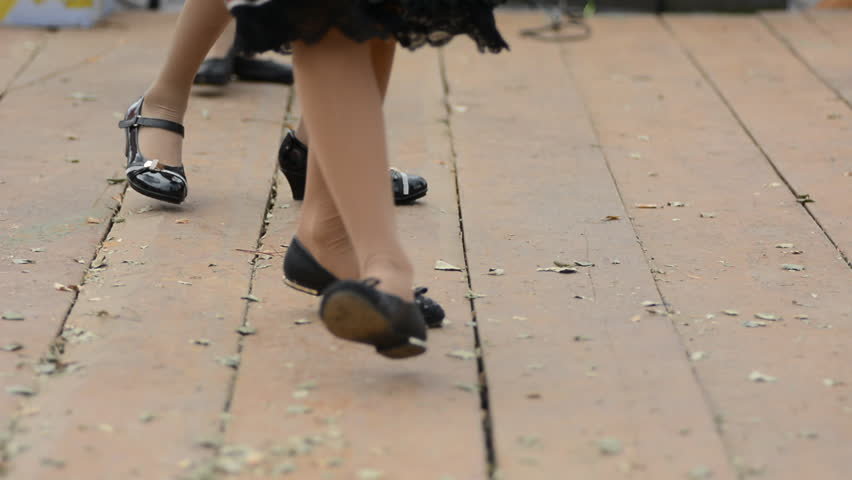 Detail of the Finno-Finnish girls national dance in national clothes on the wooden floor. Dancing legs women | Shutterstock HD Video #16727482