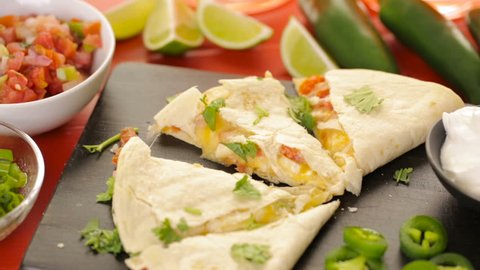 Sliced quesadilla filled with cheese, chicken and pico de gallo.
