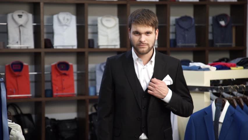 Fashion Man In Suit Posing In Wear Shop | Shutterstock HD Video #16764772