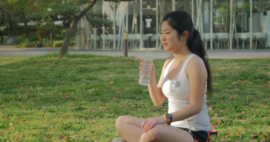 Young Stressed Business Woman Doing Yoga Outside Office -9403