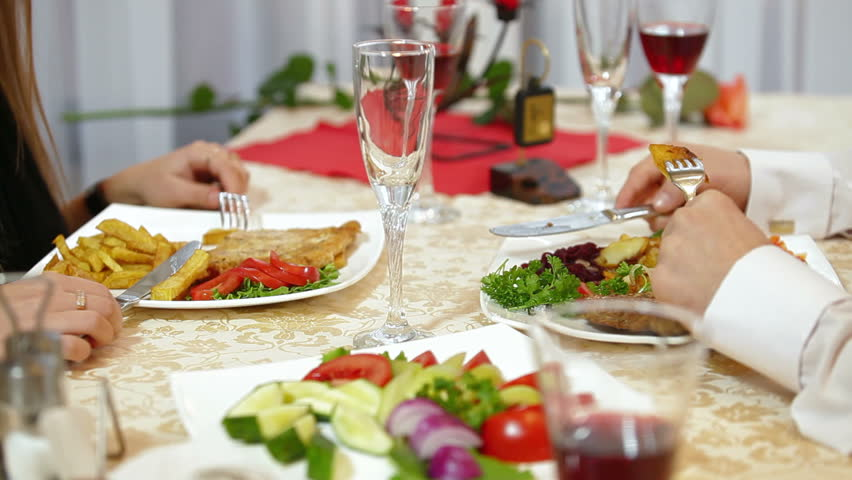 Dining Table With Food panning shot of place setting at wedding reception. food and