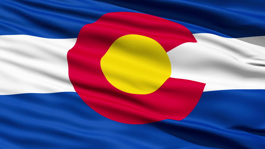 Waving Flag Of The US State Of Colorado with a stylised design depicting the red earth, golden sunshine, snow-capped mountains and blue skies.