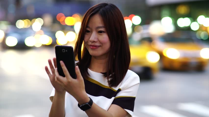 37486a6adf1 attractive young asian women using smart phone tablet in the city browsing  the internet online. urban people lifestyle background. networking with  social ...
