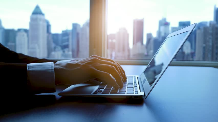Working on laptop computer in modern office desk analyzing financial  profits progress. business charts diagrams background. online banking from home. city skyline window view  | Shutterstock HD Video #16830772