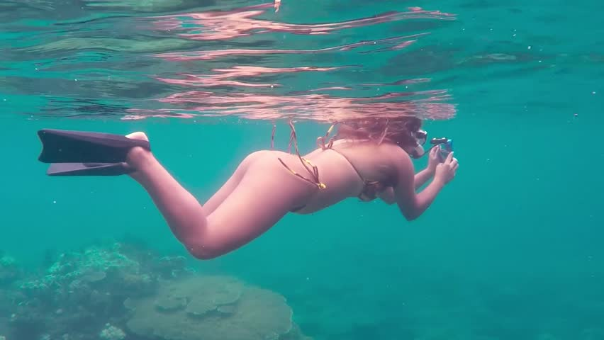 Woman takes pictures underwater while snorkeling in Thailand #16847572