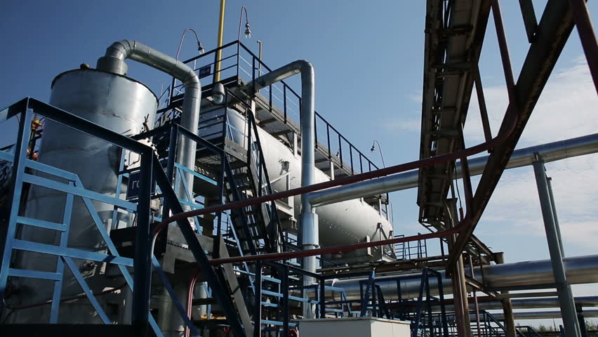 Modern facility with tube or powerful process area at the oil depot or tank farm. Rock-oil extraction for supply. Engineering complex for refining and delivery. Dolly outdoors in sunny summer. Nobody | Shutterstock HD Video #16857316